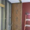 Demo broom closet in kitchen for new floor to ceiling pantry cabinets.