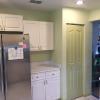 "Original kitchen with 30"" uppers and small bi-fold pantry"